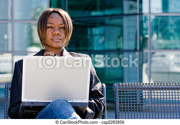 African american business woman with computer - csp2283856