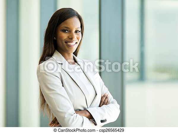 african american business woman with arms crossed in office - csp26565429