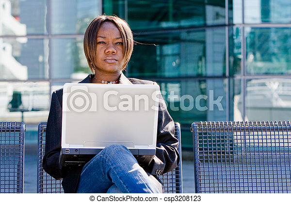 African american business woman with computer - csp3208123