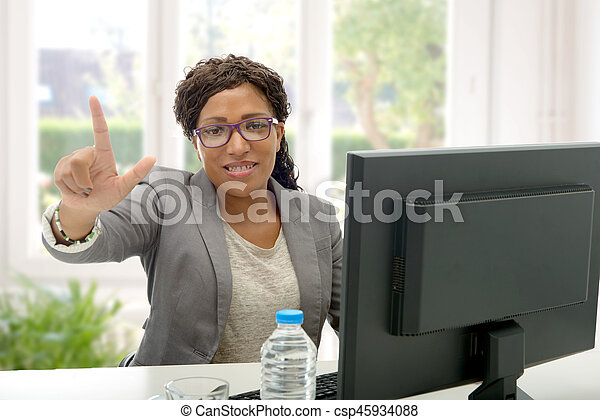 African American business woman working with computer - csp45934088