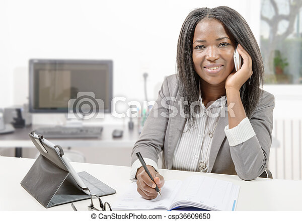 African american business woman working with tablet - csp36609650
