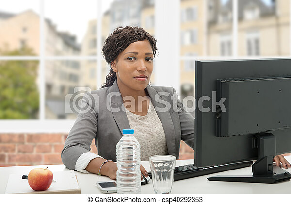 African American business woman working with computer - csp40292353