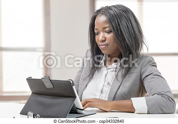 African american business woman working with tablet - csp34332840