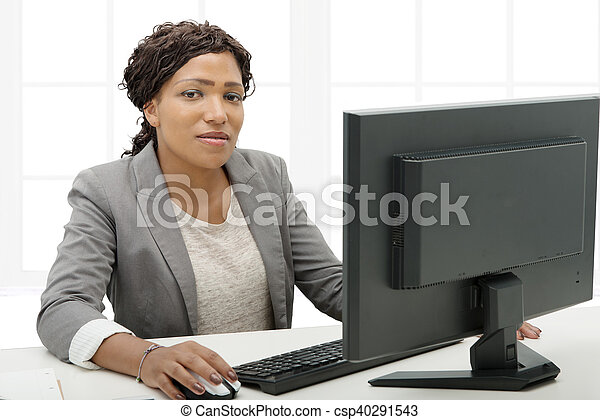 African American business woman working with computer - csp40291543