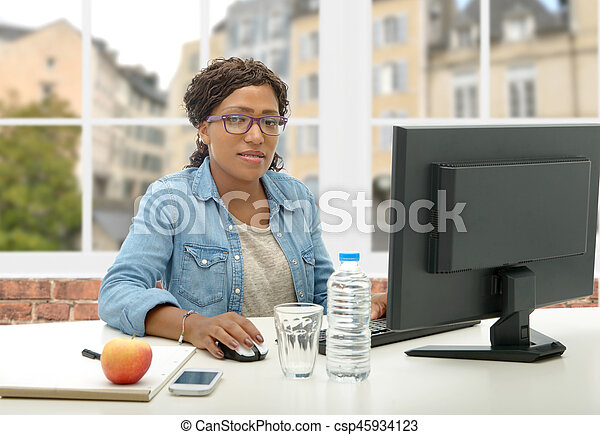 African American business woman working with computer - csp45934123
