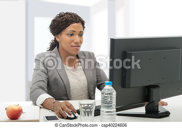 African american business woman working with computer - csp40224606