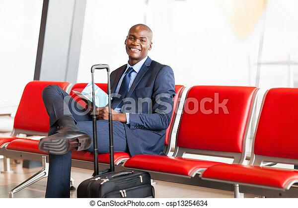 african American businessman waiting flight - csp13254634