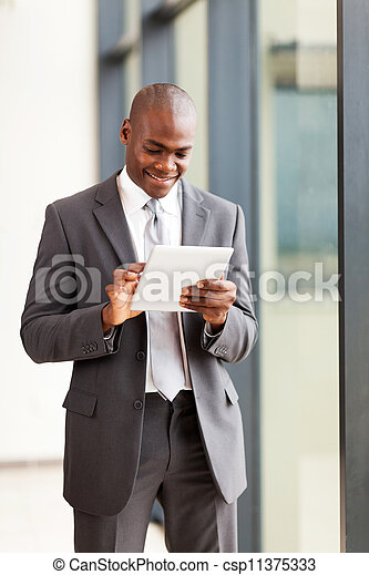african american businessman with tablet computer in office - csp11375333