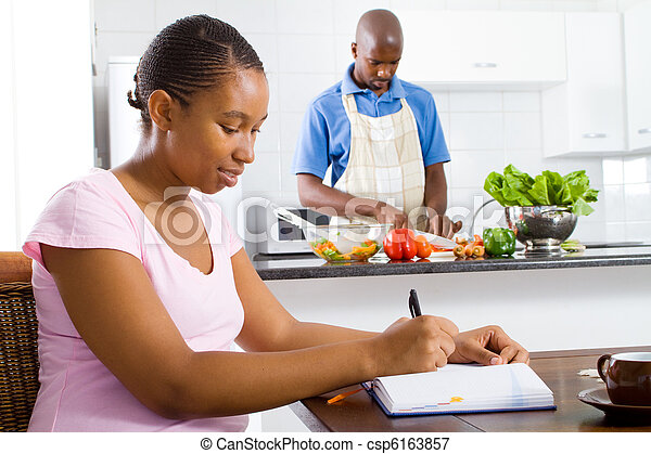 african american couple in kitchen - csp6163857