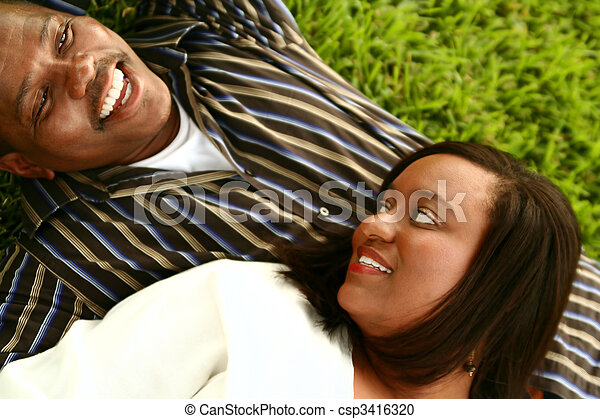 African American Couple Laying On The Ground - csp3416320