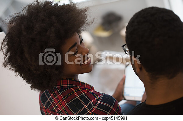 african american couple using tablet at home - csp45145991