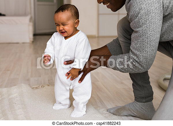 African American dad with his mixed race baby son - csp41882243