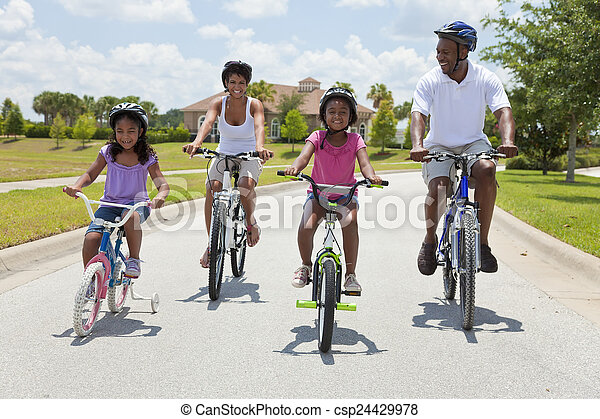 African American Family Parents and Children Cycling - csp24429978