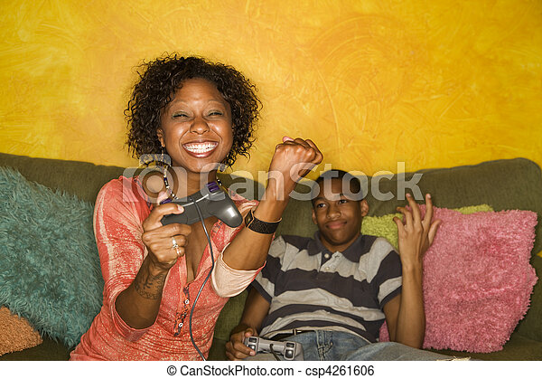 African-American family playing video game - csp4261606