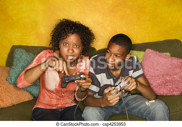 African-American family playing video game - csp4253953