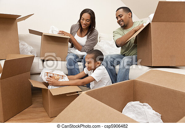 African American Family Unpacking Boxes Moving House - csp5906482