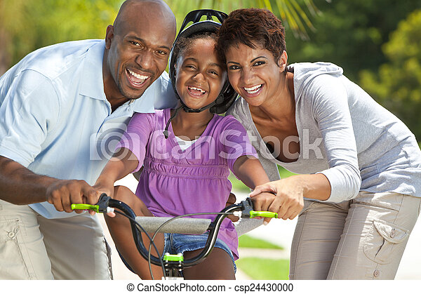 African American Family WIth Girl Riding Bike & Happy Parents  - csp24430000