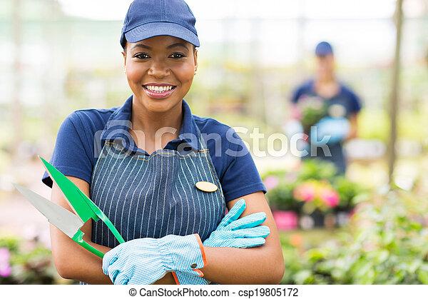 african american female nursery worker portrait - csp19805172