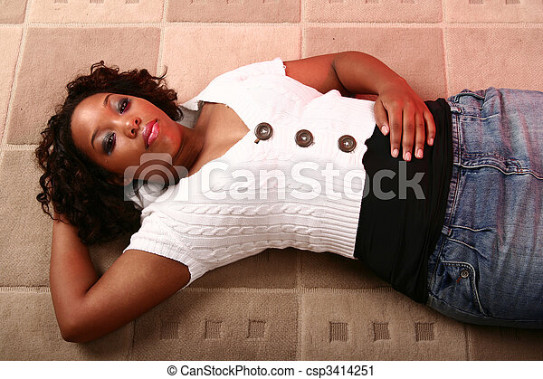 African American Girl Laying On The Floor Relaxing - csp3414251