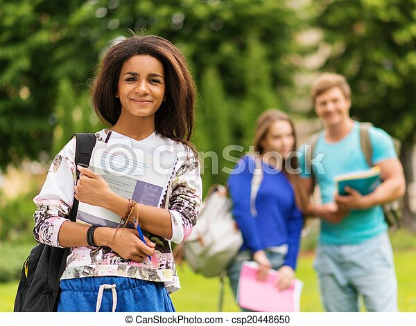 African-american girl student in a city park on summer day  - csp20448650