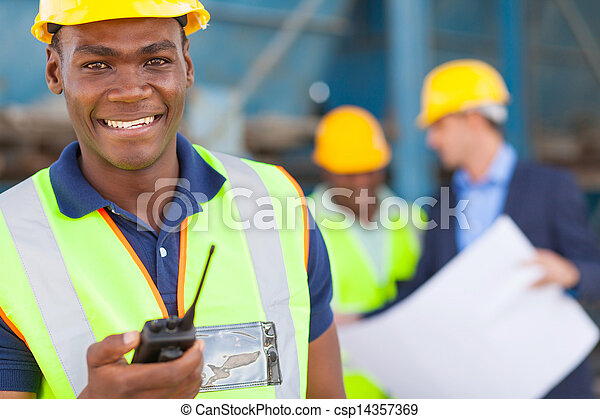 african american industrial worker with walkie talkie - csp14357369
