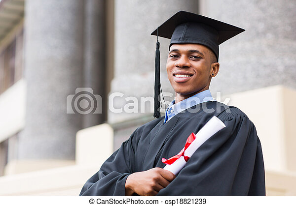 african american male graduate standing outside college - csp18821239