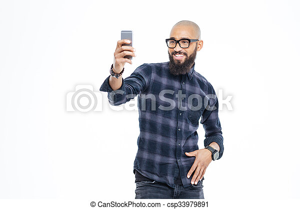 African american man with beard smiling and taking selfie - csp33979891