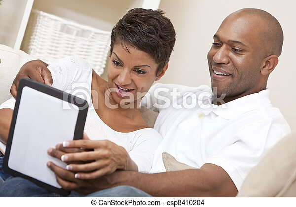 African American Man Woman Couple Using Tablet Computer - csp8410204