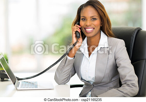 african american office worker talking on the phone - csp21165235