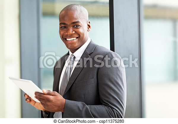african american office worker with tablet computer - csp11375280