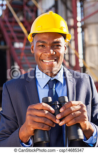 african american petrochemical manager with binoculars - csp14685347