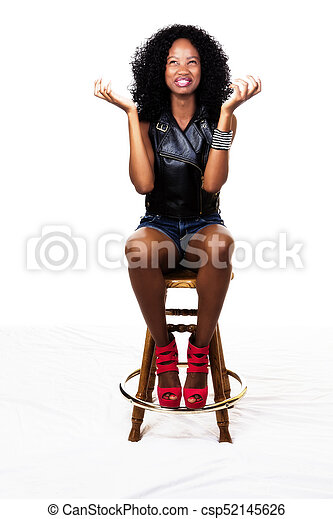 African American   Sitting On Stool Hands Out - csp52145626