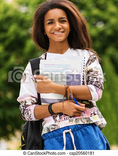 African-american student girl in a city park on summer day - csp20560181