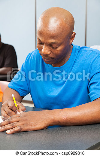 African American Student Taking Test - csp6929816