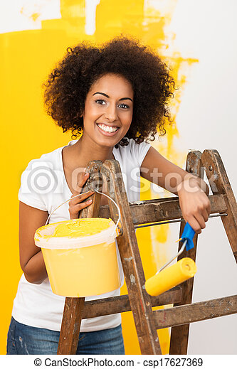African American woman doing redecorating - csp17627369