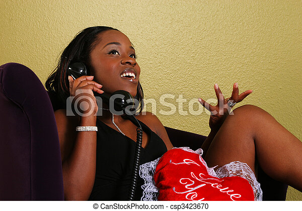 African American Woman Gossiping On The Phone - csp3423670
