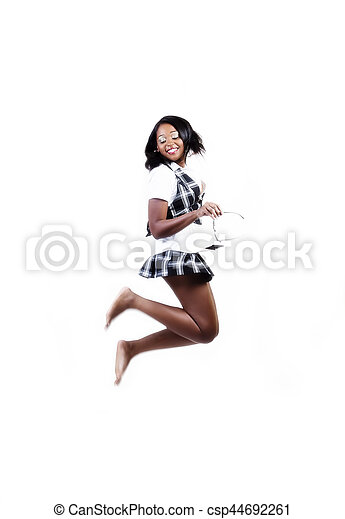 African American Woman In Plaid Skirt And Vest Jumping - csp44692261