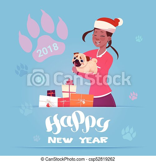 african american woman in santa hat holding cute pug dog winter holidays 2018 banner new year