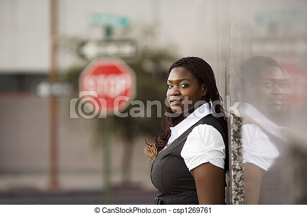 African American Woman Leaning against a Building - csp1269761
