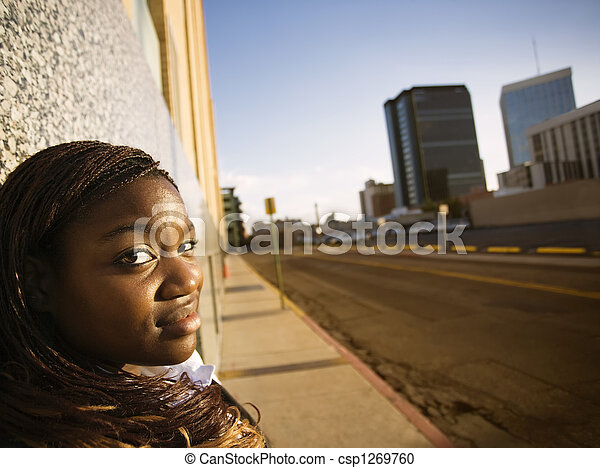 African American Woman Leaning against a Building - csp1269760