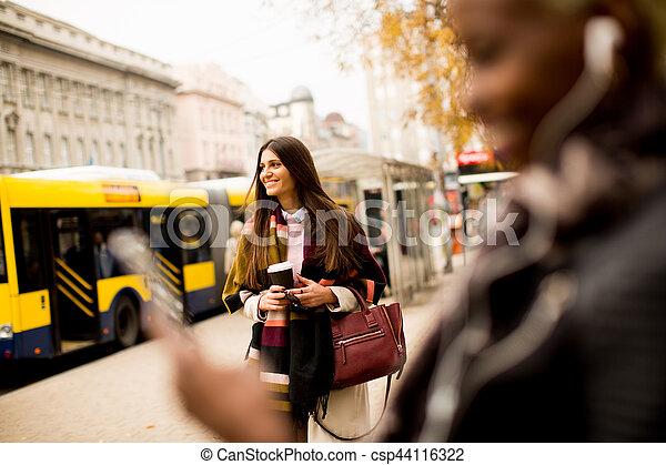 African american woman listening music outdoor - csp44116322