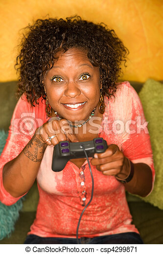 African-American woman plays video game - csp4299871
