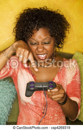 African-American woman plays video game - csp4269319