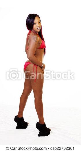 African American Woman Red Bikini High Heels - csp22762361
