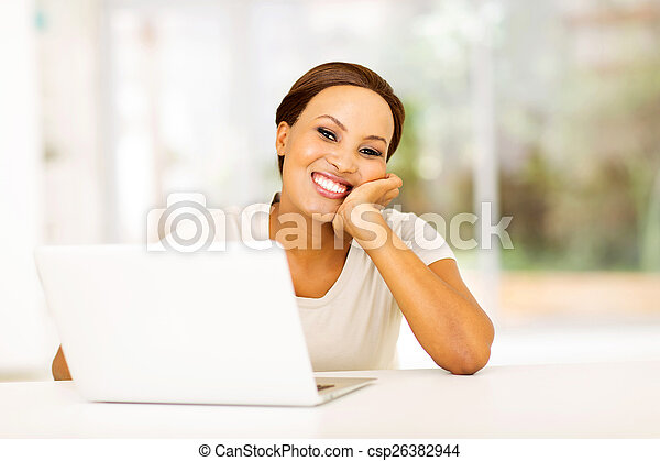african american woman relaxing at home - csp26382944