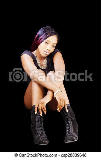 African American Woman Sitting In Black Leotards - csp28839648