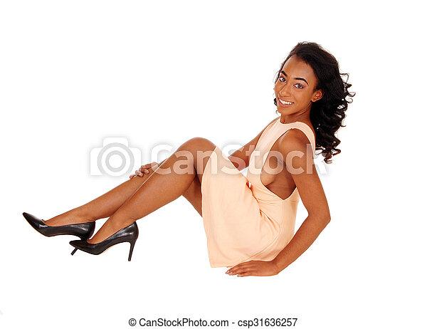 African american woman sitting on floor. - csp31636257