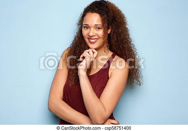 african american woman smiling against blue background - csp58751400