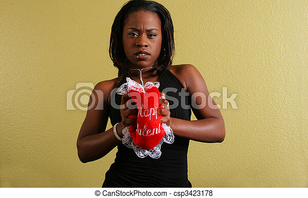 African American Woman Squeezing Love Pillow - csp3423178