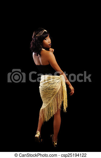 African American Woman Standing Black And Gold Outfit - csp25194122